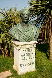 """Photograph of a bronze bust of a man. It rests on a stone plinth, on which the words """"Gaius Valerius Catullus 87 AC–54 AC"""" are written."""