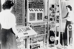 Two women are seen by the Colossus computer.