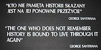 "A black placard with white text reading: ""KTO NIE PAMIẸTA HISTORII SKAZANY / JEST NA JEJ PONOWNE PRZEŻYCIE"" / GEORGE SANTAYANA / ""THE ONE WHO DOES NOT REMEMBER / HISTORY IS BOUND TO LIVE THROUGH IT / AGAIN"" / GEORGE SANTAYANA"