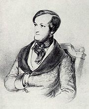The head and upper body of a young white man with dark hair receding where it is parted on the left. Sideburns run the full length of his face. He wears a cravat and his right hand is tucked between the buttons of his coat.