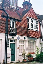 Colour photograph of the front of a three-storey house