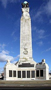 The Naval War Memorial in Southsea: a large stone pillar and a plaque commemorating the fallen soldiers of World War II