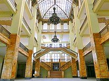 Atrium of a large, multilevel building of a defunct department store flagship. Note the damaged ceiling in the background