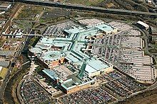Meadowhall, a large shopping centre building on the site of the former East Hecla Steel Works