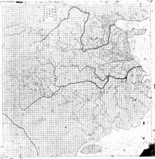 Inverted image of a stone rubbing, comprising a map of eastern China, complete with detailed rivers. The area of the map covered by land features a near perfect grid pattern, which because it does not overlap any text, is clearly the work of the original mapmaker.