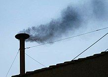 Black smoke coming from the Sistine Chapel chimney before the election of Pope Benedict XVI
