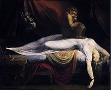 Painting of a woman wearing white sleeping and dreaming. She is laying on a bed with her arms thrown back in abandon. On top of her chest is sitting a grotesque goblin. From behind the red curtains at the back of the painting, a horse's head with dull white eyes is peering.