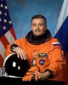 Seated Russian astronaut