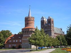 Medieval town gate Mitteltor and St Mary Church
