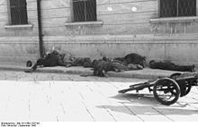 Bodies of uniformed men on a sidewalk