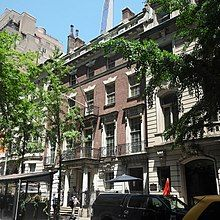 The brick facade of 11 West 54th Street is between 13 West 54th Street is at left and 7 West 54th Street is at right