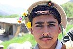 Young Pashai man with flowers in his hair.jpg
