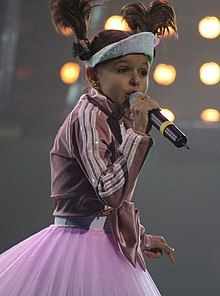 Photograph of Ksenia Sitnik performing at the 2005 Junior Eurovision Song Contest
