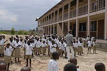 group of children at school in white shirt and khaki shorts uniforms