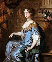 Formal seated portrait of Mary. She wears a grey satin decollatage dress and a blue satin cloak with gold swathes at her shoulders. Her hair is formally arranged in curls and she wears a necklace of large grey pearls.