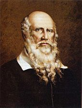 color lithograph of the bust of an elderly white man with a bald head except for long white hair on the sides of his head and a long beard that extends to his breast. His white collar is visible above a simple black coat. His eyes are locked on the viewer's and his countenance is serious but calm.