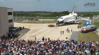 Atlantis being greeted by a crowd after its final landing