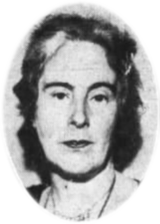 A black-and-white photograph of a woman's head