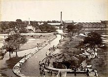 Sepia photograph of buildings around the water canal