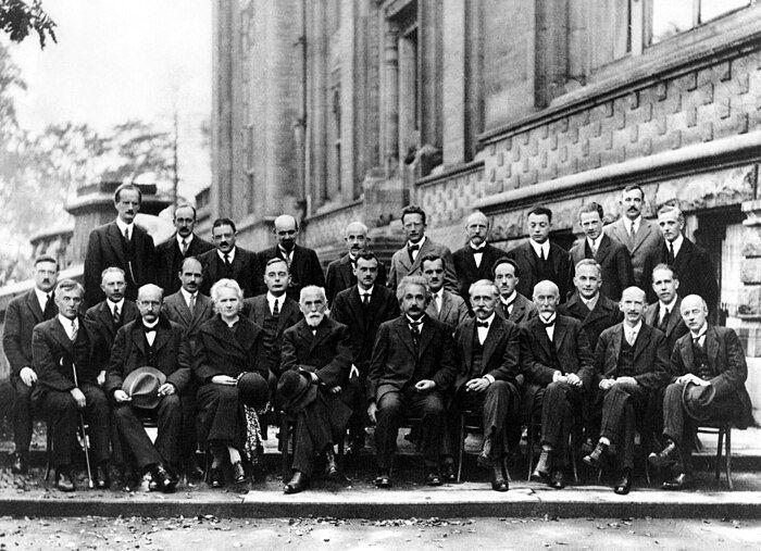 A. Piccard, E. Henriot, P. Ehrenfest, E. Herzen, Th. De Donder, E. Schrödinger, J.E. Verschaffelt, W. Pauli, W. Heisenberg, R.H. Fowler, L. Brillouin; P. Debye, M. Knudsen, W.L. Bragg, H.A. Kramers, P.A.M. Dirac, A.H. Compton, L. de Broglie, M. Born, N. Bohr; I. Langmuir, M. Planck, M. Curie, H.A. Lorentz, A. Einstein, P. Langevin, Ch. E. Guye, C.T.R. Wilson, O.W. Richardson Fifth conference participants, 1927. Institut International de Physique Solvay in Leopold Park. Image