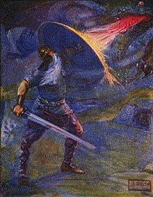 Beowulf, holding a sword, blocks a dragon's fire with his shield.
