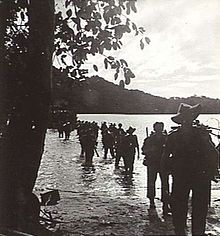 Infantry wading ashore from a landing craft