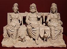 Statue of three figures, seated side by side