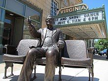 A statue of Roger Ebert outside the Virginia Theater.
