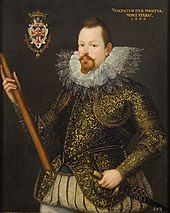"""Artist's representation of a man with pointed beard, heavy ruff collar and embroidered jacket, holding a staff in his right hand and a sword in his left. A badge or coat of arms is shown top left, and a legend: """"Vincentius Dux Mantua, Mont Ferrat 1600"""" is visible top left."""