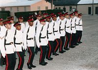 Soldiers in white-and-black dress uniforms