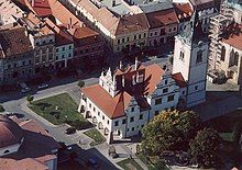 A building with towers in a town