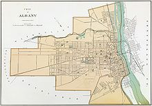 A yellowed map of the city showing streets, the Hudson River, and municipal boundaries; Albany is shaded to distinguish from neighboring towns.
