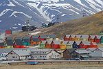 Houses in Longyearbyen, a snow-covered mountain in the background