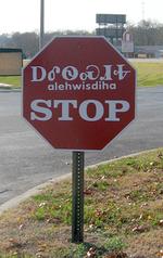 Cherokee stop sign.png