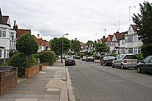 A wide suburban street with semi-detached housing