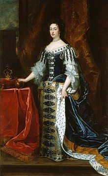 1690 painting of Mary. An orb is on the table to her right, as is the crown, which is placed on a cushion.