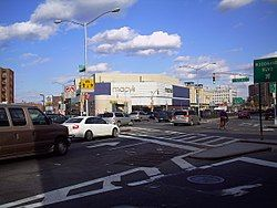 The intersection of Queens Boulevard and 57th Avenue; the Macy's store in Queens Center is in the background