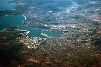 November 2014 aerial photograph of Olbia. The airport and the harbour are both visible.