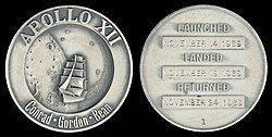 Apollo 12 Flown Silver Robbins Medallion (SN-1).jpg
