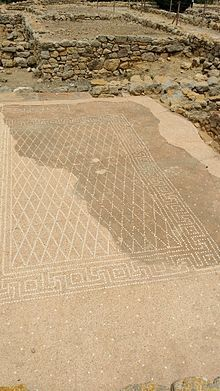"""A mosaic in the Neapolis. """"Ηδύκοιτος"""", """"the pleasure of lying down"""" can be seen at the top."""
