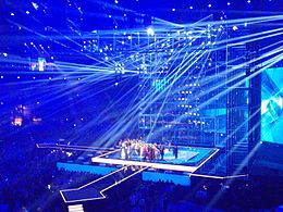 Photograph of the stage at the 2014 contest, with some of the contestants on stage
