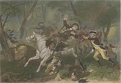 A wounded British officer falls from his horse after being struck by gunfire; another British officer to his rights puts his hands forwards to support the wounded rider; troops skirmish in the background; men lie dead at the riders feet.