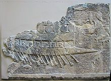 WA 124772: An Assyrian warship carved into stone (700–692 BC) from the reign of Sennacherib. Ninevah, South-West Palace, Room VII, Panel 11. British Museum.