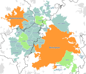 Map of the West Midlands conurbation in 2011, with Travel to Work Areas overlaid. The Birmingham and Wolverhampton sub-divisions are highlighted in orange, the Dudley, Walsall and Solihull sub-divisions are highlighted in green.