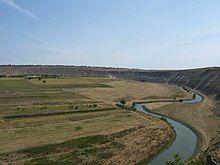 River winding past low farmland