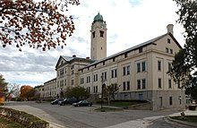A building and clock tower at Fort Leavenworth