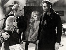 Barrymore, made up as Svengali, with a beard, staring intently at Marian Marsh, seated with her eyes closed peacefully, whose shoulders are being held defensively by Bramwell Fletcher, who looks concerned