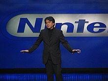 Satoru Iwata giving a presentation.