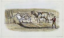 man guiding two horses pushing machine