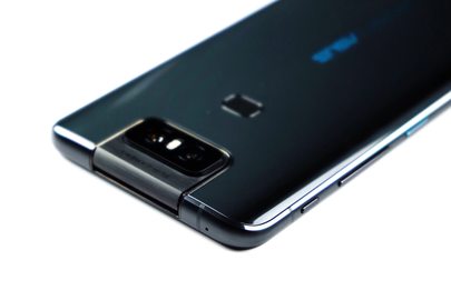 The flip camera and a rear-mounted fingerprint scanner visible on the glass back, along with buttons on the edge